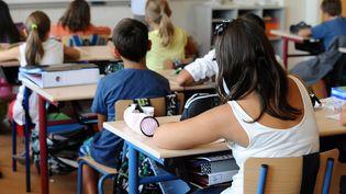 Dans une école de primaire, à Ramonville (Haute-Garonne), le 3 septembre 2013. (REMY GABALDA / AFP)