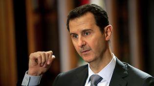 Bachar Al-Assad, le 19 janvier 2014, lors d'un entretien avec l'AFP, au palais présidentiel syrien, à Damas. (JOSEPH EID / AFP)