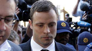 Le champion paralympique sud-africain Oscar Pistorius arrive au tribunal de Pretoria (Afrique du Sud), le 11 septembre 2014, pour la lecture du verdict dans son procès pourle meurtre de sa petite amie en 2013. (SIPHIWE SIBEKO / REUTERS)