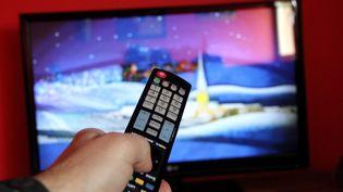 Une télécommande pour changer le programme de sa télévision. (MAXPPP)