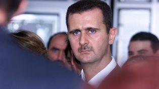 Le président syrien Bachar Al-Assad à l'institut du monde arabe à Paris, le 26 juin 2001. (JACK GUEZ / AFP)