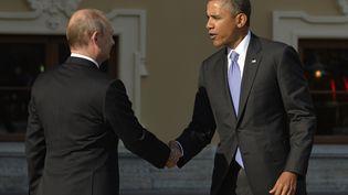 Le président russe Vladimir Poutine (à gauche) et le président américain Barack Obama, le 5 septembre 2013 à Saint-Pétersbourg (Russie). (ERIC FEFERBERG / AFP)