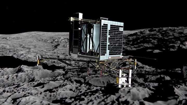 """Une représentation du robot Philae à la surface de la comète """"Tchouri"""". (MEDIALIAB / ESA / AFP)"""