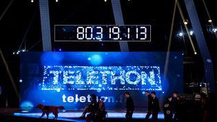 Le compteur de dons du Téléthon, le 4 décembre 2016, à l'hippodrome de Longchamp à Paris. (PHILIPPE LOPEZ / AFP)