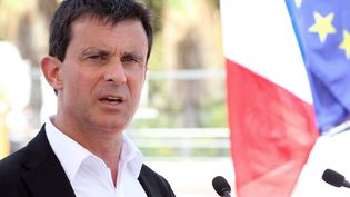 Le ministre de l'Intérieur Manuel Valls, le 6 août 2013 à Cannes (Alpes-Maritimes). (JEAN CHRISTOPHE MAGNENET / AFP)