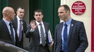 Le nouveau Premier ministre, Manuel Valls, sort de son domicile, le 1er avril 2014, à Paris. (FRED DUFOUR / AFP)