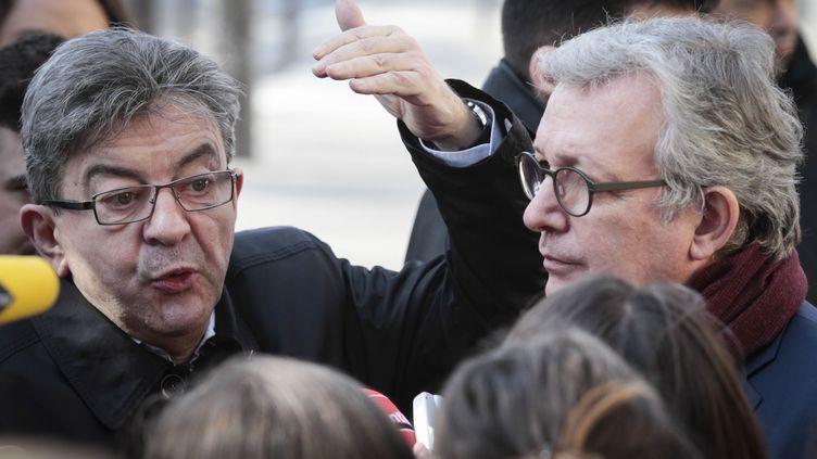 Jean-Luc Mélenchon (La France insoummise) et Pierre Laurent (Parti communiste), à Paris, le 24 février 2017. (GEOFFROY VAN DER HASSELT / AFP)