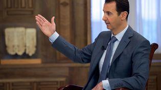 Le président syrien Bachar Al-Assad, le 26 mars 2015 à Damas (Syrie), lors de l'interview qu'il a accordée à la chaîne américaine CBS. ( SANA / AFP)