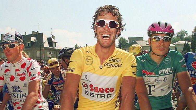 Mario Cipollini hilare à côté de Laurent Brochard et Erik Zabel (PATRICK KOVARIK / AFP)