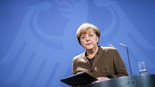Angela Merkel lors de son point de presse à Berlin, le 23 décembre 2016 (MICHAEL KAPPELER / DPA / AFP)
