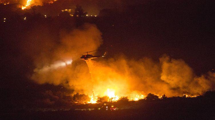 Un feu de forêt à Yucaipa, en Californie (Etats-Unis), le 5 septembre 2020. (RINGO H.W. CHIU / AP / SIPA)