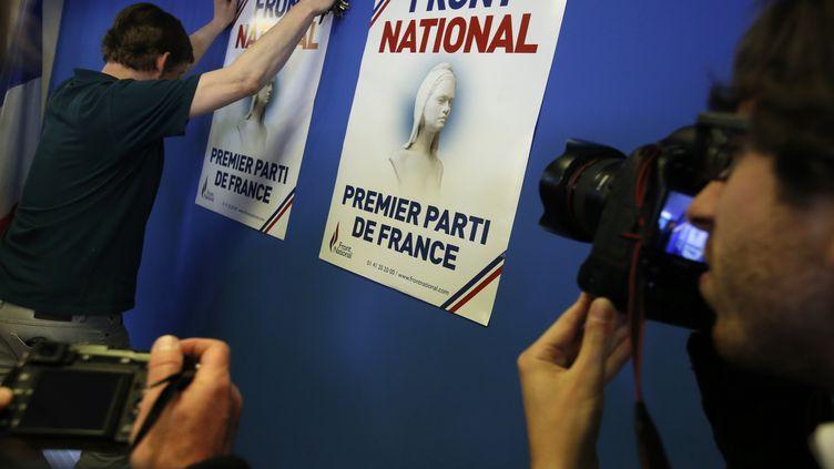 Des posters affichés au siège du Front national, à Nanterre (Hauts-de-Seine), le 25 mai 2014. (CHRISTIAN HARTMANN / REUTERS)