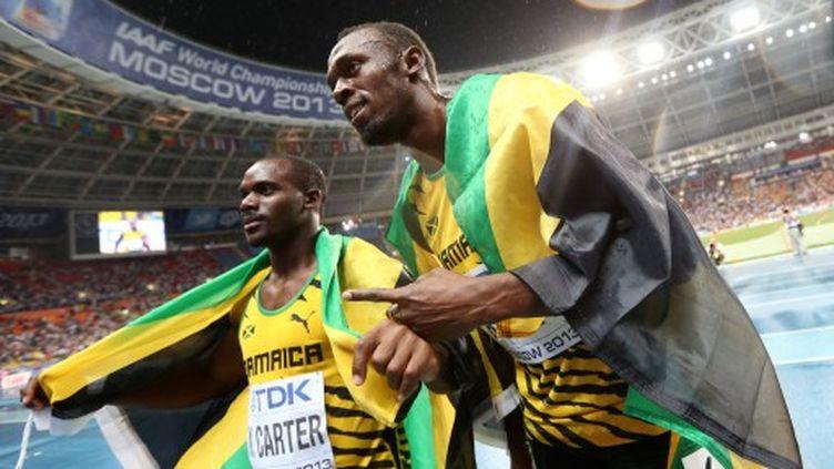 Nesta Carter aux côtés de Usain Bolt lors des Championnats du Monde de Moscou en 2013. (FRANCK FIFE / AFP)