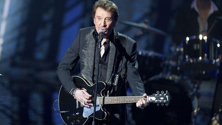 Johnny Hallyday se produit aux NRJ Music Awards, le 28 janvier 2012 à Cannes (Alpes-Maritimes). (NIVIERE-TV / NMA12 / SIPA)