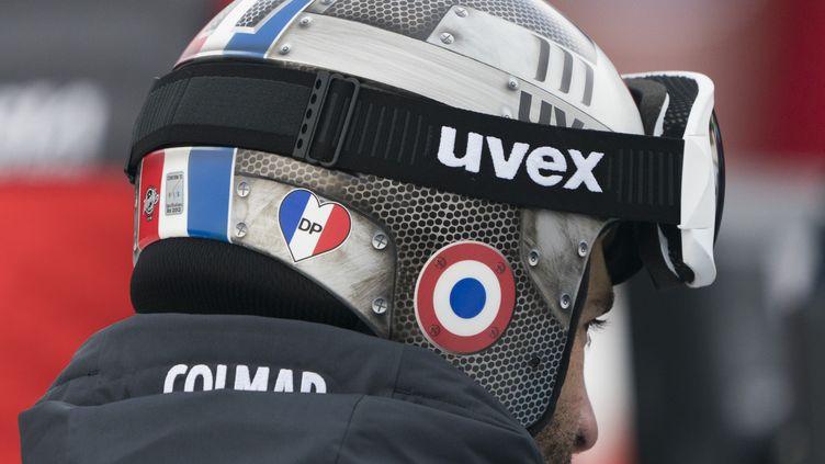 Les descendeurs français avaient été autorisés à rendre hommage à leur ex-partenaire David Poisson, lors des épreuves de Coupe du monde, en arborant un coeur tricolore sur leur casque.  (DON EMMERT / AFP)