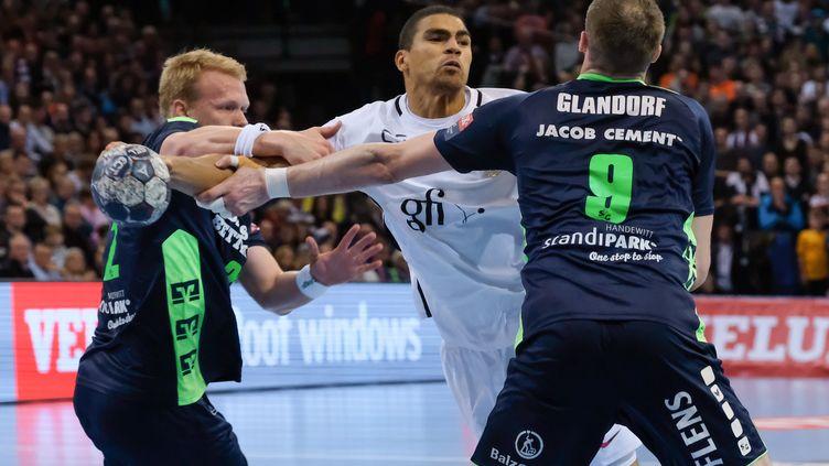 Le PSG de Daniel Narcisse a dû s'employer face à Flensburg (AXEL HEIMKEN / DPA)