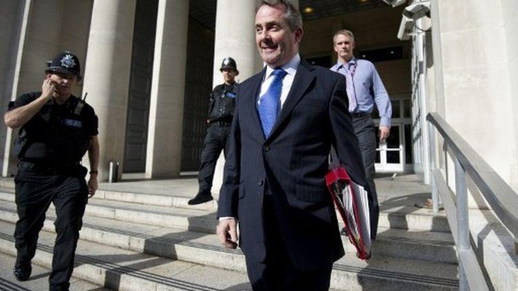 Liam Fox à la sorite du ministère de la Défense, à Londres, le 10 octobre. (Carl Court / AFP)