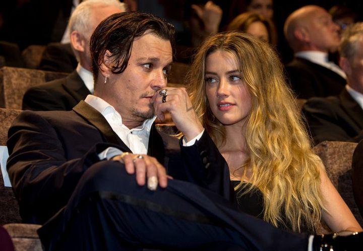 Johnny Depp et son épouse Amber Heard au festival de Venise en 2015  (HUBERT BOESL / DPA)