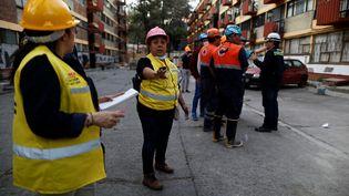 Evacuation de la population à Mexico (Mexique) au moment du séisme, vendredi 16 février 2018. (EDGARD GARRIDO / AFP)