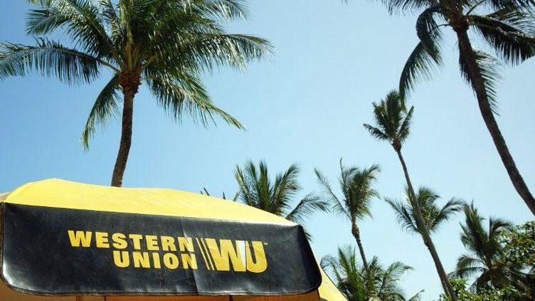 La société Western Union surtaxe les transferts d'argent vers l'Afrique, selon l'ODI.   (SOEREN STACHE / ZB / Picture-Alliance/AFP)