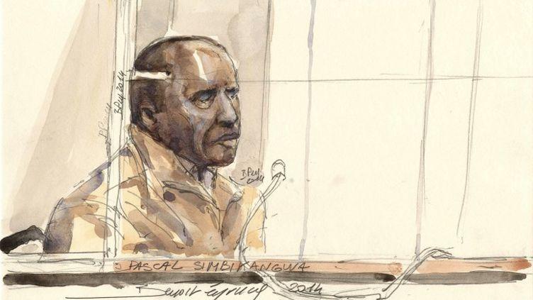 Pascal Simbikangwa, ex-capitaine de la garde présidentielle au Rwanda,lors de son procès pour complicité dans le génocide des Tutsis en 1994,le 4 février 2014 à Paris. (BENOIT PEYRUCQ / AFP)
