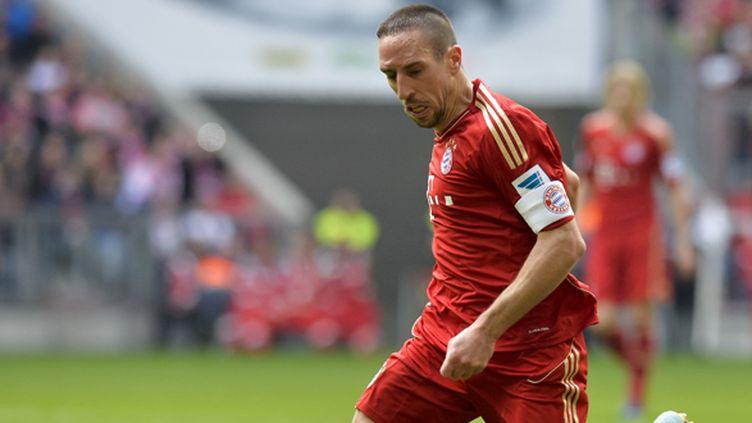 Ribéry avec le brassard de capitaine (GUENTER SCHIFFMANN / AFP)