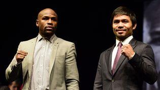 Les boxeurs Floyd Mayweather et Manny Pacquiao, le 2 mai 2015 à Las Vegas (Etats-Unis). (FREDERIC J. BROWN / AFP)