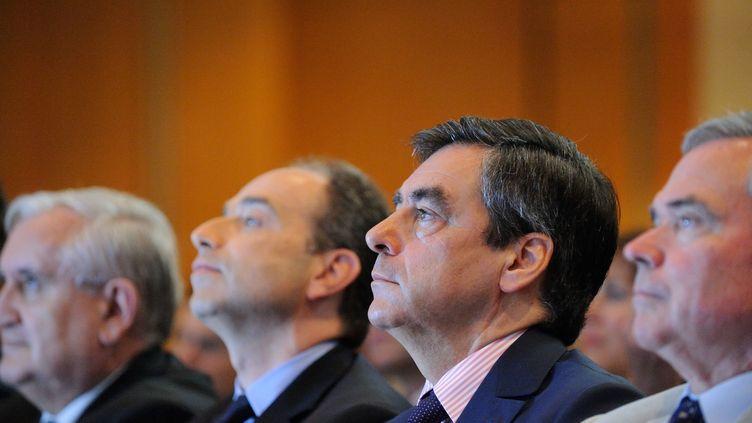 De g. à dr.,Jean-Pierre Raffarin, Jean-François Copé, François Fillon et Bernard Accoyer, le 26 mai 2012, lors d'une réunion de l'UMP à Paris. (WITT / SIPA)