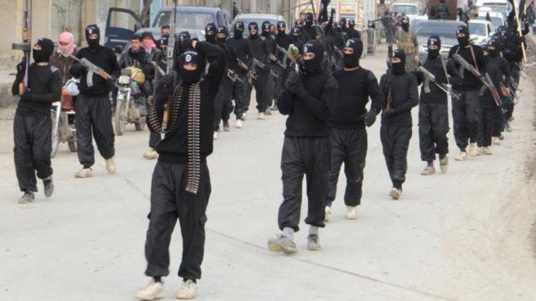 (Des combattants d'Al-Qaida, liés à l'armée de l'Etat islamique © Reuters)