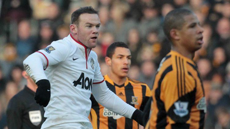Wayne Rooney juste après avoir marqué son 150e but en Premier League au KC Stadium à Hull le 26/12/2013 (LINDSEY PARNABY / AFP)