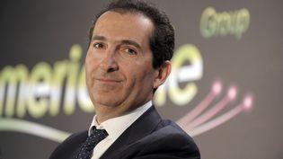 Patrick Drahi, patron d'Altice, la maison mère de Numericable, le 17 mars 2014 à Paris. (ERIC PIERMONT / AFP)