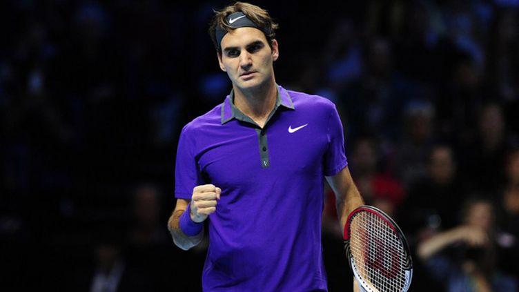 Roger Federer en mode revers  (GLYN KIRK / AFP)