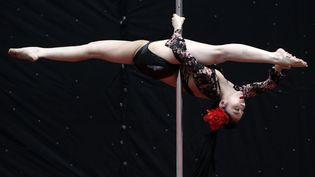 Compétition de pole-dance à Tianjin (Chine), le 2 juin 2012. (JASON LEE / REUTERS)