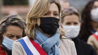 La députée LREM Yael Braun-Pivet, assiste à un rassemblement à la mémoire de Stéphanie Monferme, mère de famille et employée de la police locale, à Rambouillet, en banlieue sud-ouest de Paris, le 30 avril 2021. (LUDOVIC MARIN / POOL)