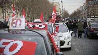 Manifestation des taxis à l'appel de leurs syndicats, contre la concurrence des VTC,le 10 février 2014, à Paris. (  MAXPPP)