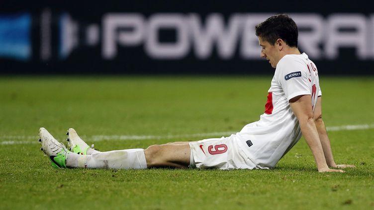 La tristesse du Polonais Lewandowski après l'élimination de son équipe dès la phase de poules de l'Euro, le 16 juin 2012. ( / X00213)