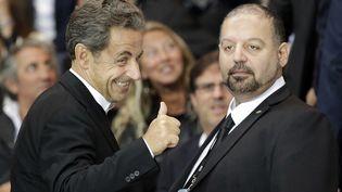 Nicolas Sarkozy dans les tribunes du Parc des Princes à Paris le 31 août 2014pour le match entre le PSG et Saint-Etienne. (KENZO TRIBOUILLARD / AFP)