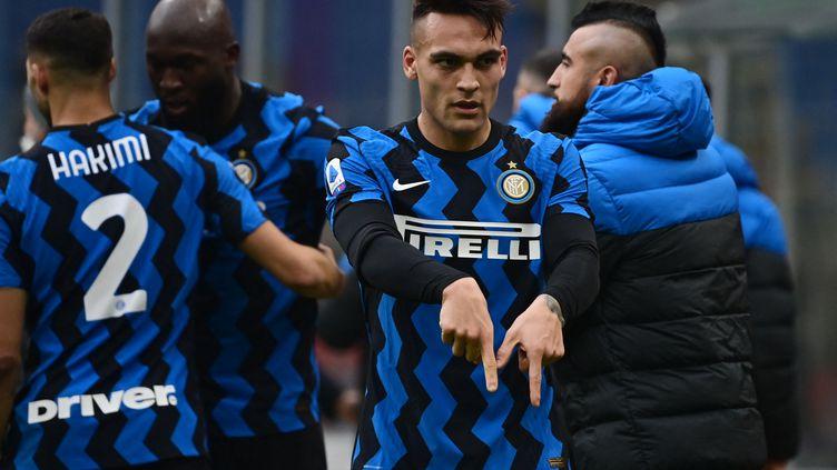 Lautaro Martinez a inscrit un doublé face à l'AC Milan (MIGUEL MEDINA / AFP)