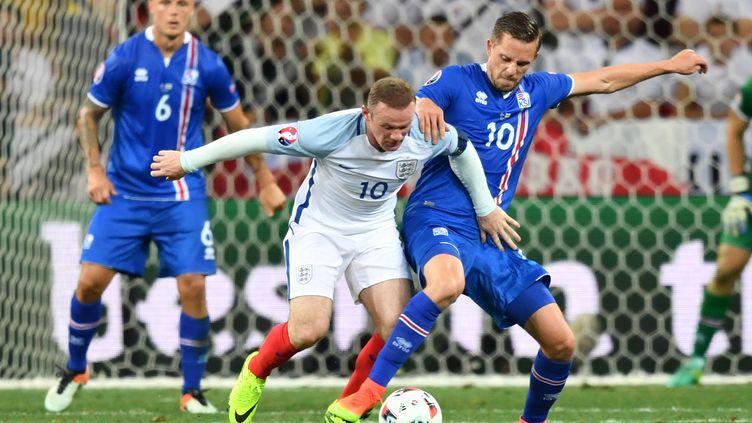 Pour sa dernière campagne internationale, Wayne Rooney voudra faire oublier l'humiliation islandaise à l'Euro. (BERTRAND LANGLOIS / AFP)