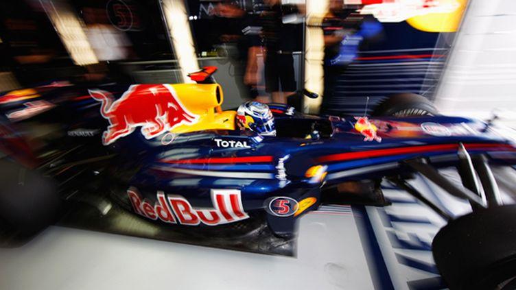 Sebastian Vettel (Red Bull) sort de son stand (MARK THOMPSON / GETTY IMAGES ASIAPAC)