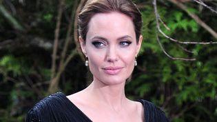 """Angelina Jolie à Londres pour présenter """"Maléfique"""", la prochaine production Disney, dont elle interprète le rôle-titre.  (CARL COURT / AFP  )"""