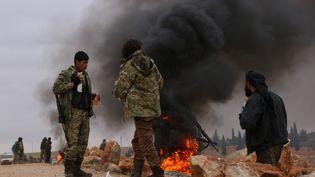 Des combattants rebelles de l'Armée syrienne libre, à Alep (Syrie), le 11 décembre 2016. (MAMUN EBU OMER / ANADOLU AGENCY / AFP)