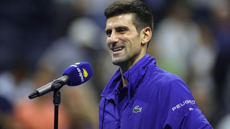 Novak Djokovic, heureux après sa qualification en finale de l'US Open 2021 suite à sa victoire face à Alexander Zverev, vendredi 10 septembre. (SARAH STIER / GETTY IMAGES / AFP)