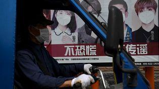 L'économie de Wuhan, épicentre du Covid-19, va pouvoir progressivement reprendre, ont annoncé les autorités locales, le 11 mars 2020. (NOEL CELIS / AFP)