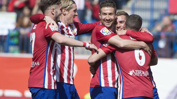 La joie des joueurs de l'Atletico Madrid (CURTO DE LA TORRE / AFP)