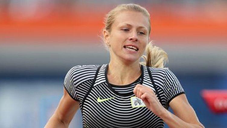La coureuse du 800 m russe Youlia Stepanova lors des championnats d'Europe d'athlétisme à Amsterdam le 6 juillet 2016. Sur son dossard, on peut lire (en anglais):«I run clean» («Je cours propre»)... (AFP - DPA - Michael Kappeler)