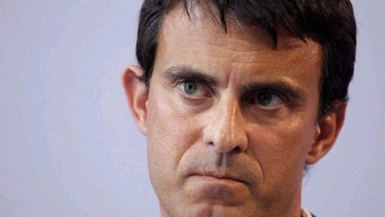"Manuel Valls assure que Dominique Strauss-Kahn ""reste"" son ""ami"". (AFP - Patrick Kovarik)"