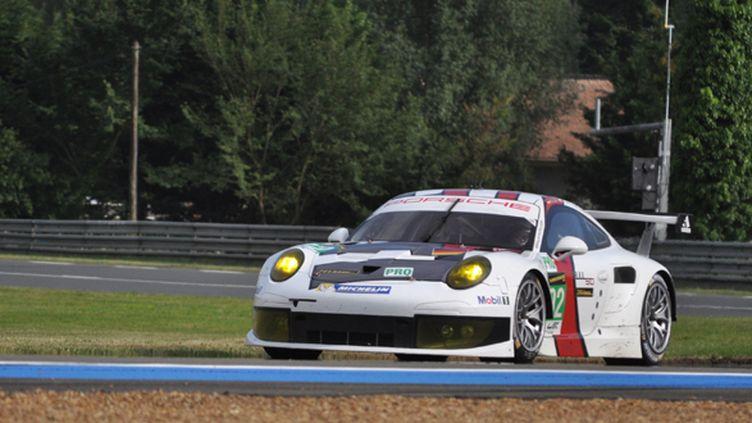 Romain Dumas au volant de la Porsche 911 RSR N.92