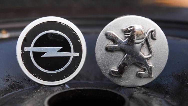 PSA a annoncé, lundi 6 mars, être parvenu un accord avec General Motors afin d'acquérir les marques Opel et Vauxhall pour 1,3 milliard d'euros. (ARNE DEDERT / DPA / AFP)