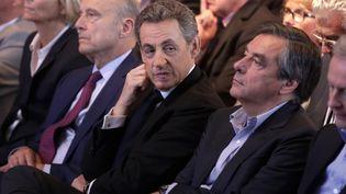 Alain Juppé, Nicolas Sarkozy et François Fillon, lors d'un meeting des Républicains à Nogent-sur-Marne (Val-de-Marne), le 27 septembre 2015. (MAXPPP)